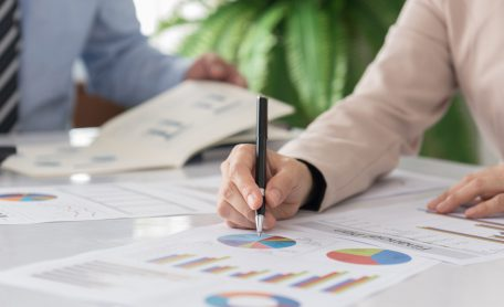 business people presentation data of financial or marketing figures, graphs and charts for reviewing market data and business strategy plan.